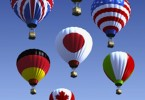 International flag hot air balloons --- Image by © Ikon Images/Corbis